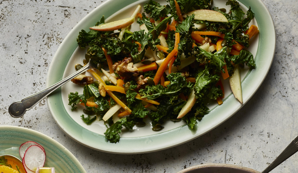 Kale, Apple and Walnut Salad served on a green dish