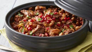 Lamb served in a grey tagine with cous cous and pomegrante pearls