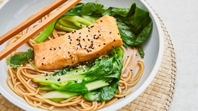 Lapsang Souchong Poached Salmon served in a white bowl with chopsticks and toppped with sesame and nigella seeds