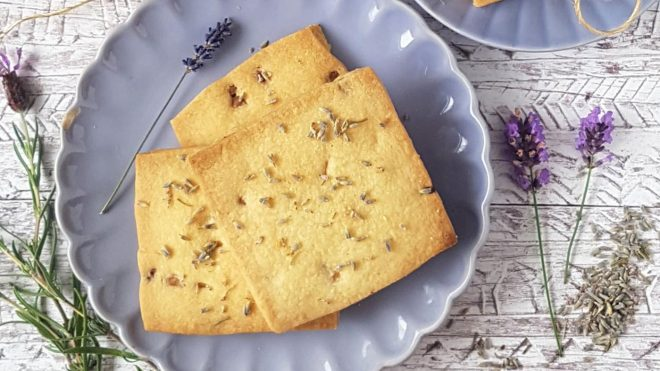 White Chocolate and Lavender Shortbread served on a purple plate surrounded by sprigs of lavender