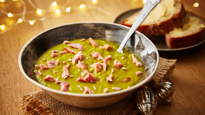 Leftover Gammon and Pea Soup, served in a grey bowl with a portion of buttered bread
