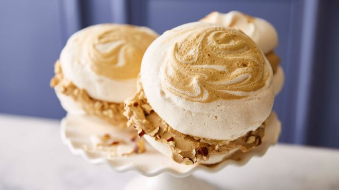 Salted Caramel and Coffee Meringue Sandwiches served on a white cake dish