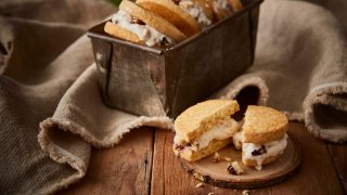 Mince Pie Ice Cream Shortbread Sandwiches served in a baking tin, with one sandwich on a wooden plate