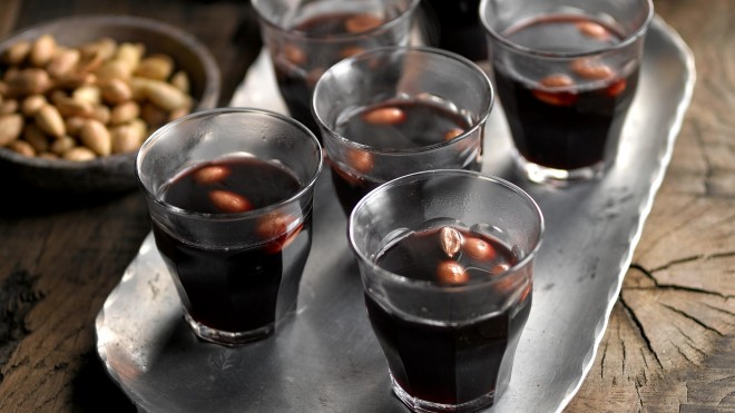 Scandinavian Spiced Mulled Wine served in six glasses with almonds in the glasses