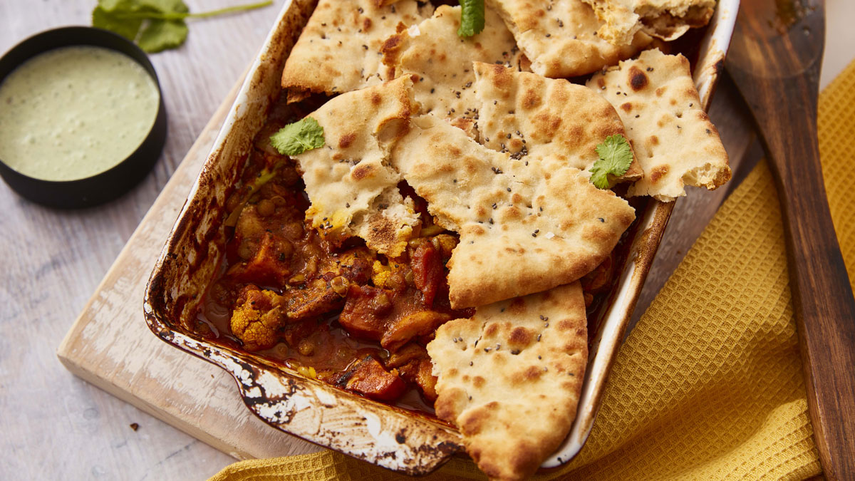 Naan Topped Chicken Tikka Pie served in a white baking dish