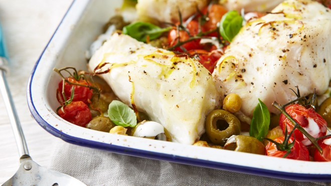 One Pot Cod Supper served in a baking dish with vine tomatoes and olives and capers