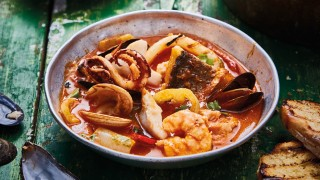 Brazilian Seafood Stewserved on a bowl with toasted ciabatta on the side