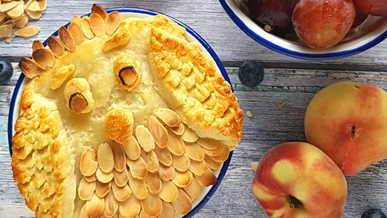 Peach, Plum and Almond Owl Pie with the pastry and almonds arranged to make the topping look like an owl