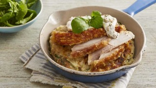 Potato and Apple Cakes with Leftover Roast Pork served in a casserole dish on top of a striped table cloth