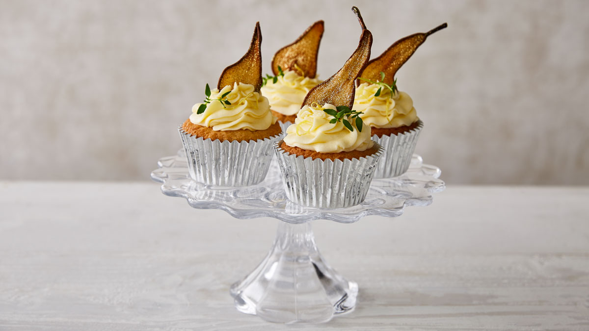 Prosecco, Pear and Elderflower Cupcakes, served on a glass dish