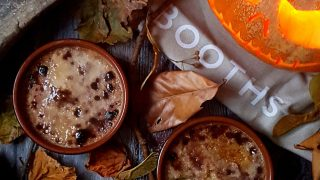 Pumpkin Pue Brulee served in ramekins surrounded by autumnal leaves and twigs