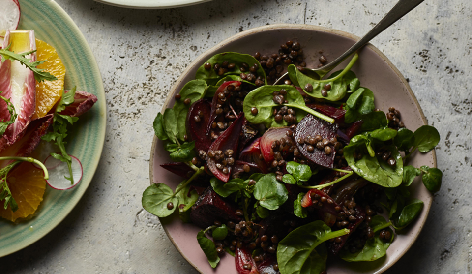 Puy Lentil and Roasted Beetroot Salad served in a lilac bowl