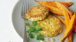 Quinoa Patties with Cauliflower and Feta served on a grey plate with sweet potato wedges