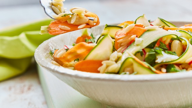 Orzo Pasta Salad served in a white bowl