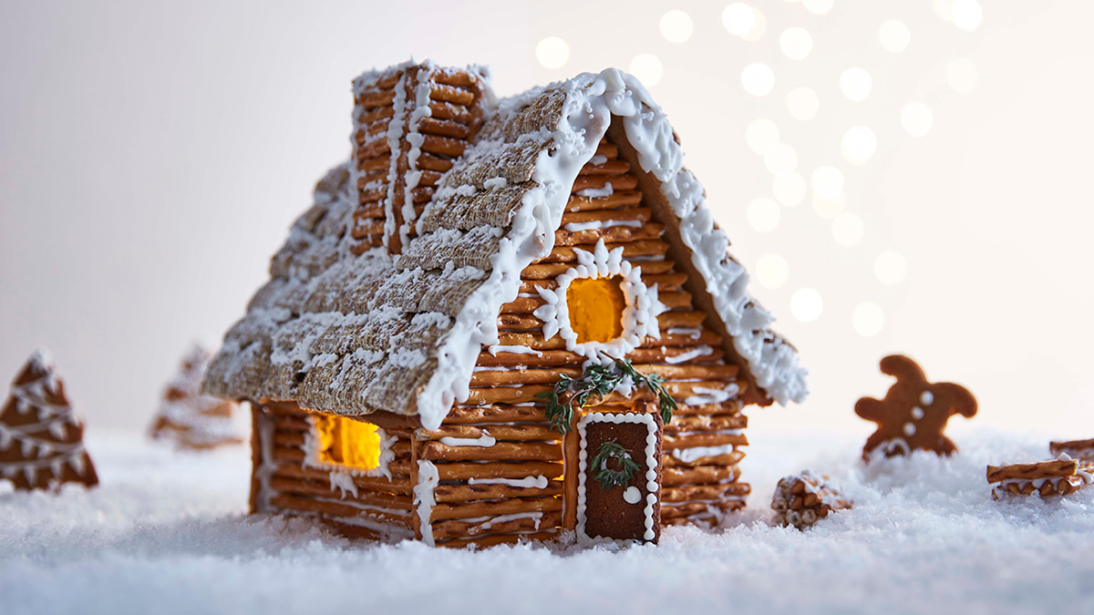 Festive Gingerbread House sat on fake snow