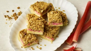 Rhubarb Traybake cut into portions and arranged on a white plate