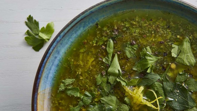 Salsa Verde served in a blue bowl and topped with cracked black pepper