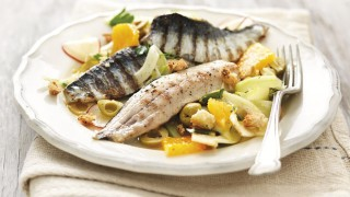 Sicilian Style Sardines with Orange and Fennel Salad served on a white plate topped with green olives and dill