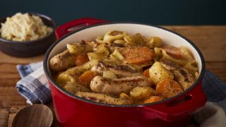 Slow Cooker Sausage Casserole served in a casserole dish on top of a wooden table