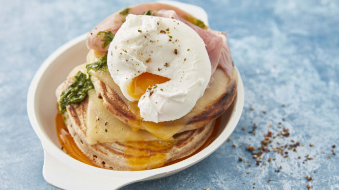 Savoury Buckwheat Pancakes served in a white dish, topped with a poached egg