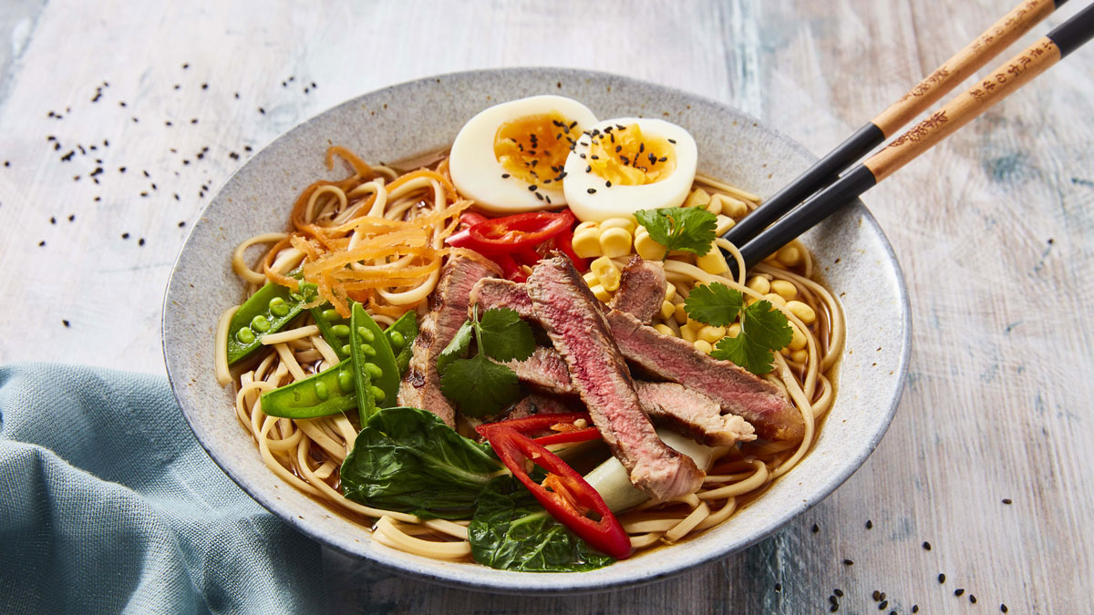 Steak Ramen Bowl served in a blue dish with chopsticks