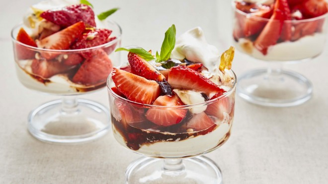 Strawberries with Black Olive Balsamic Caramel served in glass dishes with cream