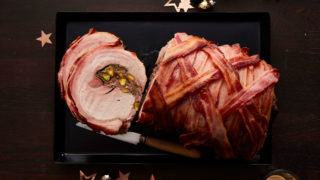 Roast Pork Loin with Sloe Gin and Cinnamon served on a roasting tray with a portion sliced