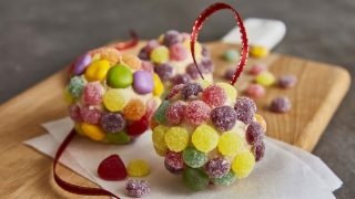 Jewelled Edible Christmas Baubles served on a wooden board