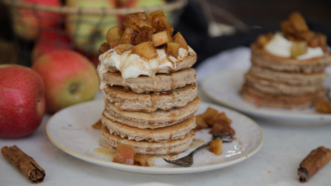Apple Pie Pancakes served in a stack on a rustic style plate