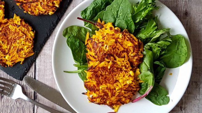Spicy Pumpkin Fritters served on a bed of green leaves