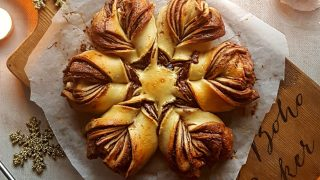Chocolate Orange Snowflake Bread served on a wooden board
