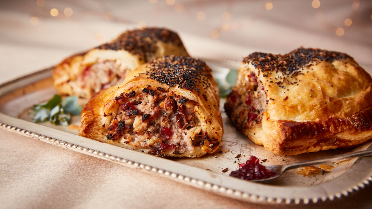 Turkey, Stuffing and Cranberry Sausage Rolls served on a white tray