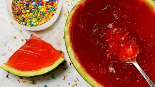 Watermelon Jelly served in a watermelon and surrounded with sprinkles
