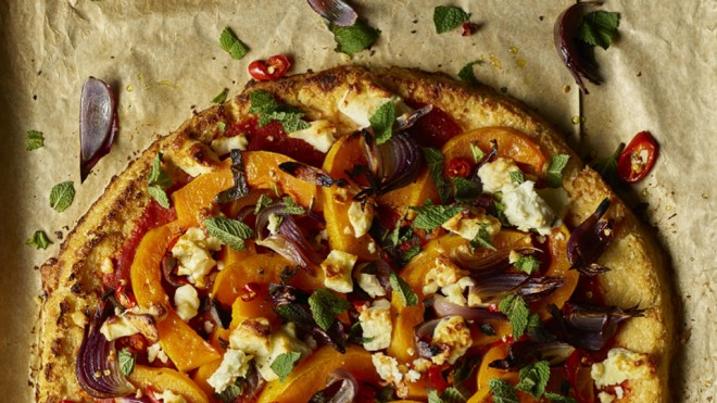 Gluten Free Winter Vegetable and Feta Tart served on baking parchment sprinkled with chopped mint